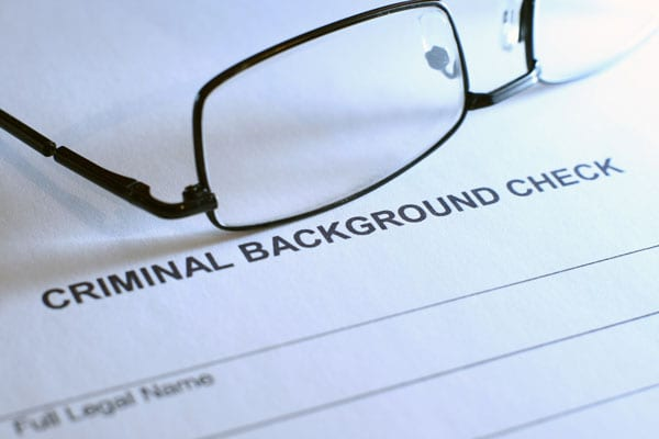 who is responsible for payment for background checks?